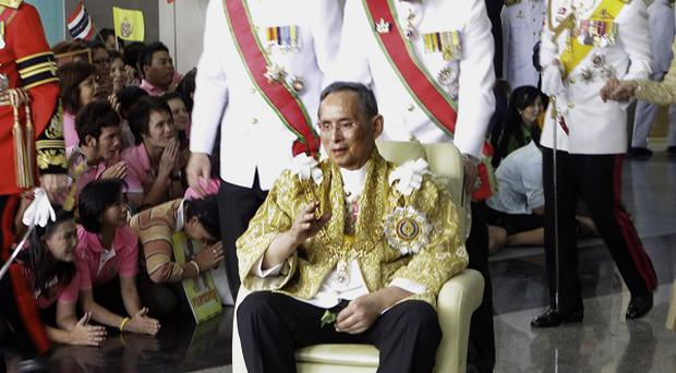 Thailand's King Bhumibol Adulyadej spoke to supporters at the ceremonial Grand Palace (AP)