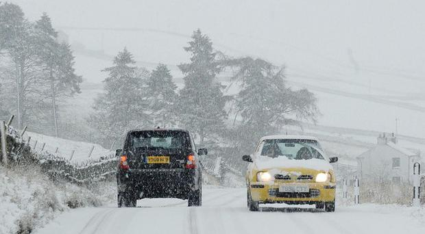 Drivers in Scotland and the north of England have been warned to expect snow and sleet