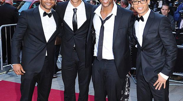 JLS sing on the X Factor charity single which has topped the charts