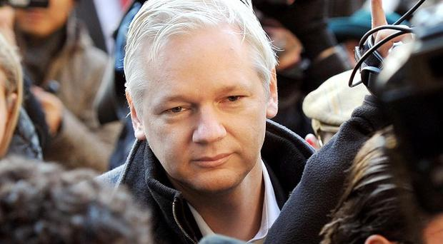 WikiLeaks founder Julian Assange arrives at the Royal Courts of Justice