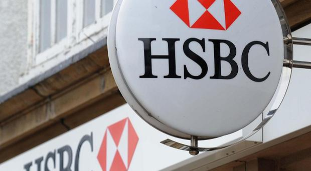 Banking giant HSBC is to axe hundreds of jobs in response to a 'very challenging' economic environment