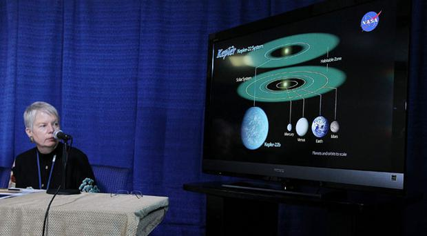 Jill Tarter, director of the Center for SETI Research looks at a graphic showing the newly discovered planet Kepler-22b during a news conference at the NASA Ames Research Center on December 5, 2011 in Moffett Field, California
