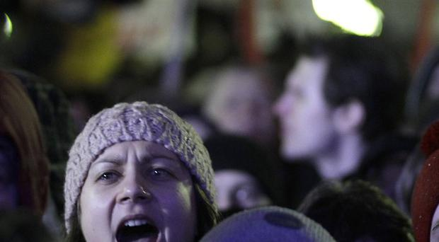 A woman shouts slogans during a rally in Moscow against Russian prime minister Vladimir Putin and his party, amid claims of a rigged election (AP)