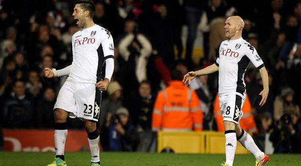 Fulham's Clint Dempsey celebrates scoring the winning goal with Andrew Johnson (right)