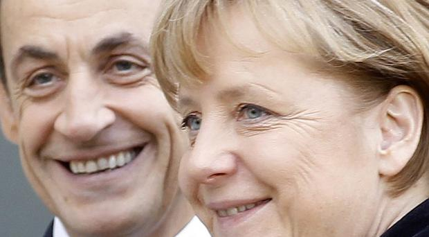 French president Nicolas Sarkozy and German chancellor Angela Merkel have proposed a a revised EU treaty by March