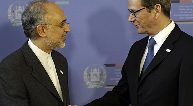 German foreign minister Guido Westerwelle, right, meets Iran's foreign minister Ali Akbar Salehi (AP Photo/Martin Meissner)