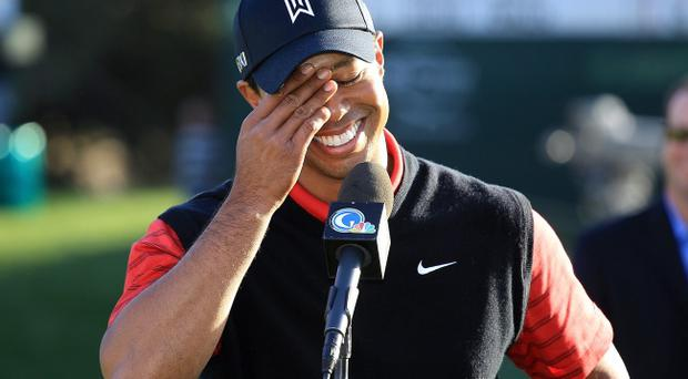THOUSAND OAKS, CA - DECEMBER 04: Tiger Woods speaks to the fans after winning the Chevron World Challenge at Sherwood Country Club on December 4, 2011 in Thousand Oaks, California. (Photo by Scott Halleran/Getty Images)