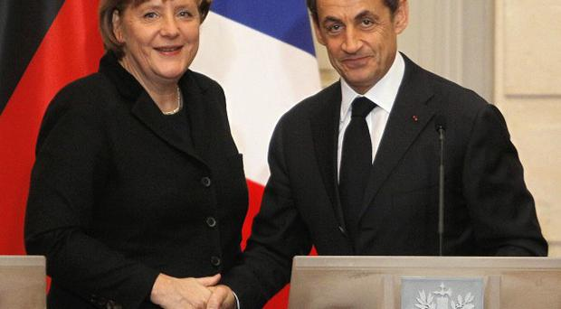 German chancellor Angela Merkel and French president Nicolas Sarkozy have renewed calls for EU treaty change to solve the eurozone crisis (AP)