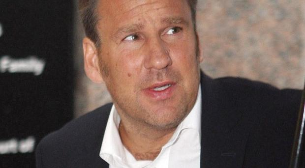 Ex-England midfielder Paul Merson will appear in court over driving with excess alcohol following a motorway crash