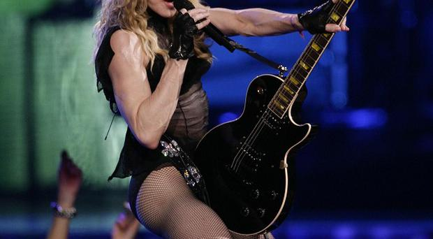 Madonna will perform at half-time during the Super Bowl in Indianapolis on February 5