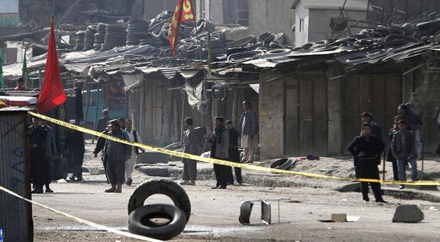 The scene of the suicide attack in Kabul which tore through a crowd of Shiite worshippers marking a holy day (AP)
