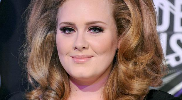 Adele has undergone surgery to save her voice