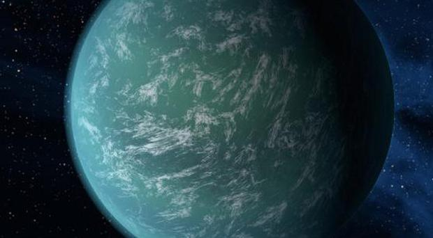 This Nasa artist rendering shows Kepler-22b, a planet known to comfortably circle in the habitable zone of a sun-like star (AP Photo/Nasa/Ames/JPL-Caltech)