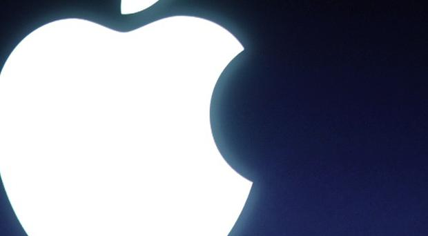 Technology giant Apple and five publishers are facing an EU inquiry into the selling of e-books (AP)