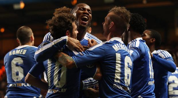 LONDON, ENGLAND - DECEMBER 06: Didier Drogba of Chelsea (C) celebrates as he scores their third goal during the UEFA Champions League Group E match between Chelsea FC and Valencia CF at Stamford Bridge on December 6, 2011 in London, England. (Photo by Scott Heavey/Getty Images)