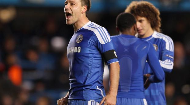 LONDON, ENGLAND - DECEMBER 06: John Terry of Chelsea celebrates victory after the UEFA Champions League Group E match between Chelsea FC and Valencia CF at Stamford Bridge on December 6, 2011 in London, England. (Photo by Scott Heavey/Getty Images)