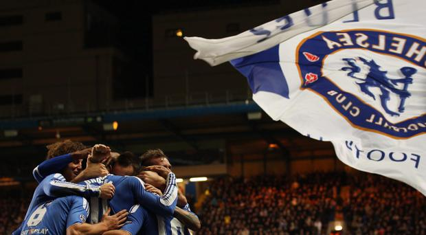 LONDON, ENGLAND - DECEMBER 06: Didier Drogba of Chelsea (11) celebrates as he scores their third goal during the UEFA Champions League Group E match between Chelsea FC and Valencia CF at Stamford Bridge on December 6, 2011 in London, England. (Photo by Scott Heavey/Getty Images)