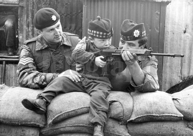 Riots : Belfast. July 1970. Private Danny Hall from Glasgow (right), of the 1st Batt. Royal Scots, saying goodbye to the regiment mascot, three and a half year old Mark Baillie, of Fortingale Street, who they handed over to the replacing regiment, the 2nd Batt. the Coldstream Guards. Receiving the mini soldier is Sergent Bob Otto from Maidenhead. (28/07/70)