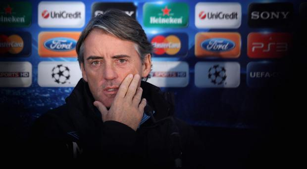 MANCHESTER, ENGLAND - DECEMBER 06: Roberto Mancini the manager of Manchester City faces the media during a press conference ahead of their UEFA Champions League Group A match against Bayern Munich at Carrington Training Ground on December 6, 2011 in Manchester, England. (Photo by Alex Livesey/Getty Images)