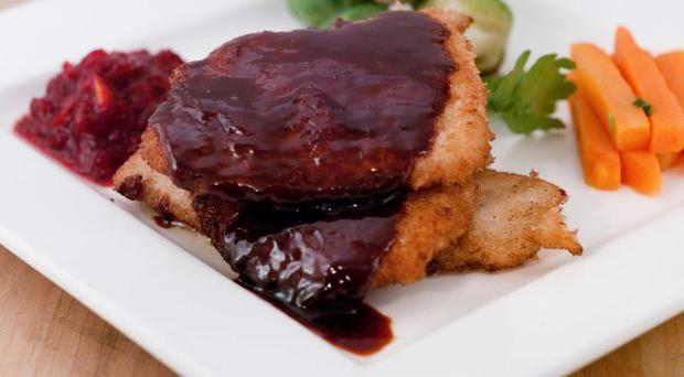 Escalope of turkey with a port sauce, cranberry and orange relish