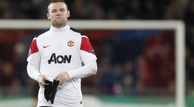 Manchester United's Wayne Rooney leaves the field at half time of the Champions League Group C soccer match against Basel at the St. Jakob-Park stadium in Basel, Switzerland, Wednesday, Dec. 7, 2011