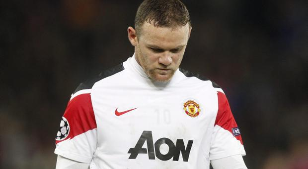 Manchester United's Wayne Rooney leaves the field after the Champions League Group C soccer match against Basel at the St. Jakob-Park stadium in Basel, Switzerland, Wednesday, Dec. 7, 2011