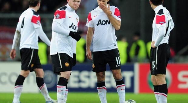 BASEL, SWITZERLAND - DECEMBER 07: Wayne Rooney and Ryan Giggs of Manchester United look on after Marco Streller of Basel scored the opening goal during the UEFA Champions League Group C match between FC Basel 1893 and Manchester United at St. Jakob-Park on December 7, 2011 in Basel, Switzerland. (Photo by Jamie McDonald/Getty Images)