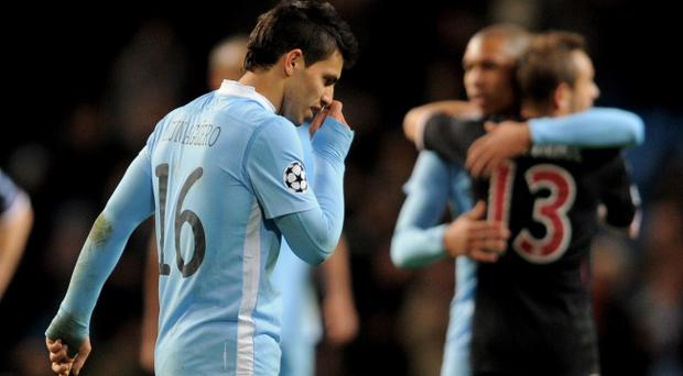 MANCHESTER, ENGLAND - DECEMBER 07: Sergio Aguero of Manchester City looks dejected at the end of the UEFA Champions League Group A match between Manchester City and FC Bayern Muenchen at the Etihad Stadium on December 7, 2011 in Manchester, England. (Photo by Michael Regan/Getty Images)