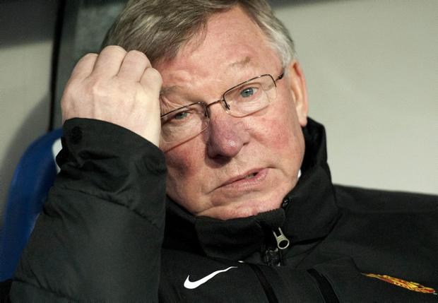 Manchester United manager Sir Alex Ferguson scratches his head before the Champions League Group C soccer match against Basel at the St. Jakob-Park stadium in Basel, Switzerland, Wednesday, Dec. 7, 2011