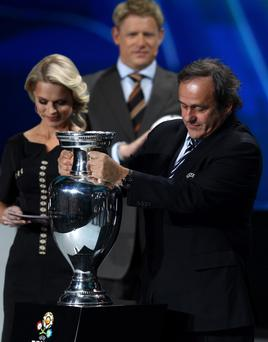 Hopefully Olga will be able to help Michel Platini free himself from the trophy before Spain inevitably win the Euro 2012 title next summer