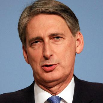 Defence Secretary Philip Hammond said female officers will be allowed to serve on Navy submarines from 2013