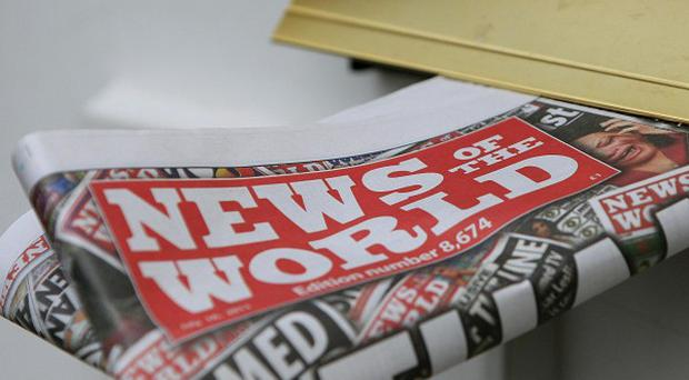 A lecturer held over allegations of phone hacking at the News of the World has been released without charge