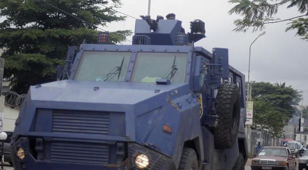 Riot police in an armoured vehicle drive the streets of Kinshasa, Democratic Republic of Congo (AP)