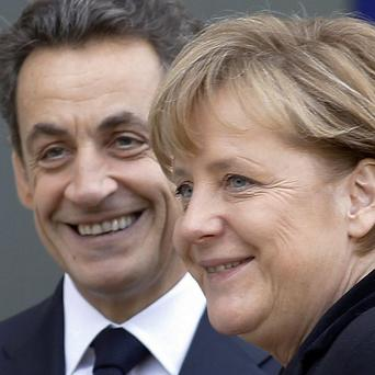 Nicolas Sarkozy and Angela Merkel are calling for a raft of new financial measures to help stabilise the euro