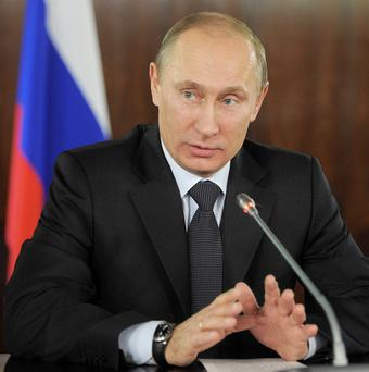 Russian prime minister Vladimir Putin said US secretary of state Hillary Clinton had encouraged election protesters in Moscow (AP)