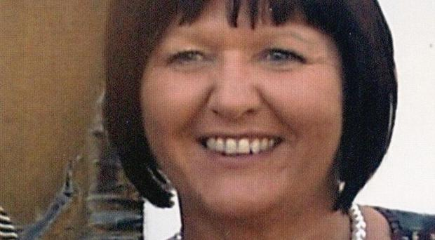 Angela Holgate, 54, who was found dead along with her mother Alice Huyton, 75, by a relative at Mrs Holgate's home near Southport