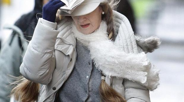 A woman struggles in high winds in Glasgow