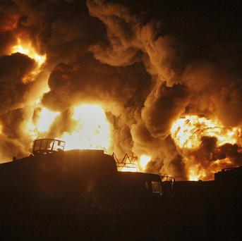 Oil tankers allegedly torched by militants at a terminal on the outskirts of Quetta, Pakistan (AP)