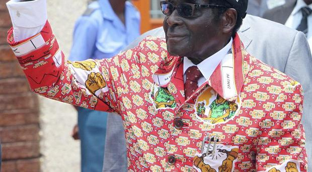President Robert Mugabe's often violent seizure of white-owned farms has disrupted the agriculture-based economy in Zimbabwe (AP)