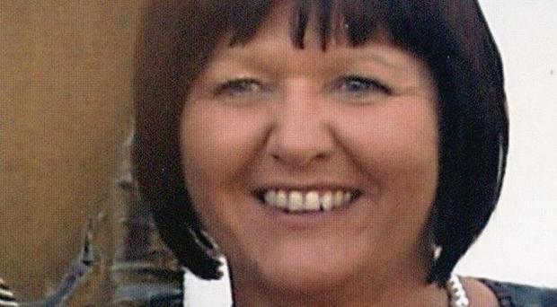 Angela Holgate, 54, who was found dead along with her mother Alice Huyton, 75 (Merseyside Police)