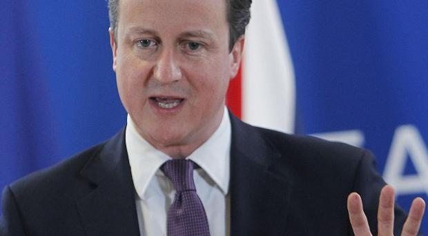 David Cameron was unapologetic at a dawn press conference in Brussels (AP)
