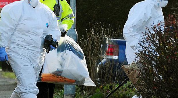 Forensics attend the scene in Melton Mowbray, after two adults and a child died following an incident at a house