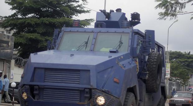 Riot police control the streets of Kinshasa in the Democratic Republic of the Congo (AP)
