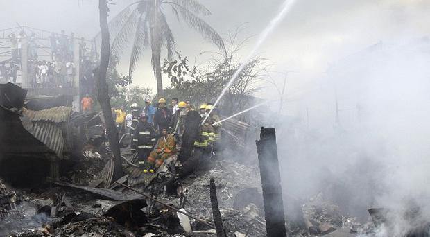 A light aeroplane has crashed into a school building near the Philippine capital Manila (AP)