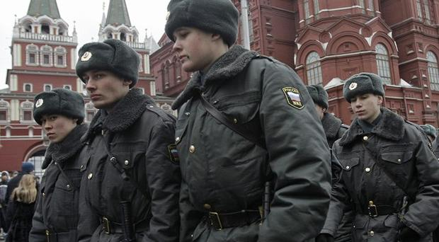 Russian police troops patrol near a closed Red Square in Moscow amid protests against alleged election fraud (AP)