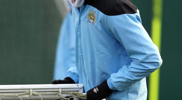 MANCHESTER, ENGLAND - DECEMBER 06: Mario Balotelli of Manchester City looks on during a training session ahead of their UEFA Champions League Group A match against Bayern Munich at Carrington Training Ground on December 6, 2011 in Manchester, England. (Photo by Alex Livesey/Getty Images)