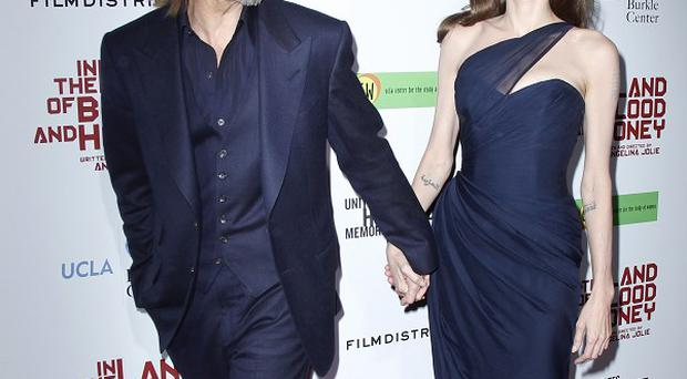 Brad Pitt walked the red carpet and showed his support for Angelina Jolie