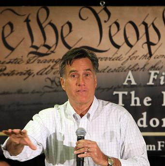 Republican presidential candidate Mitt Romney has been criticised over a bet he made with rival Rick Perry (AP)
