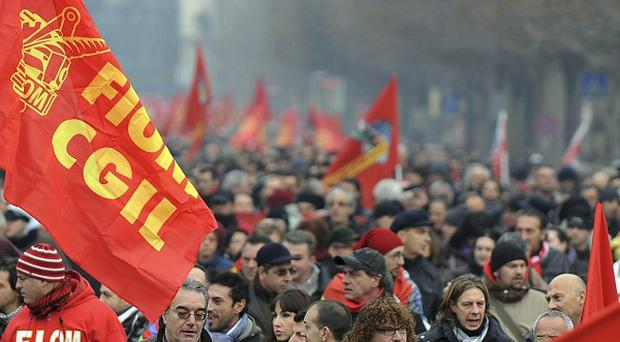Metalworkers march through Turin as part of a strike to protestat austerity measures that Premier Mario Monti hopes will save the country from financial ruin (AP)