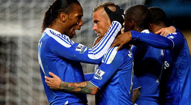 LONDON, ENGLAND - DECEMBER 12: Raul Meireles (R) of Chelsea is congratulated by teammate Didier Drogba (L) after scoring a goal to level the scores at 1-1 during the Barclays Premier League match between Chelsea and Manchester City at Stamford Bridge on December 12, 2011 in London, England. (Photo by Julian Finney/Getty Images)